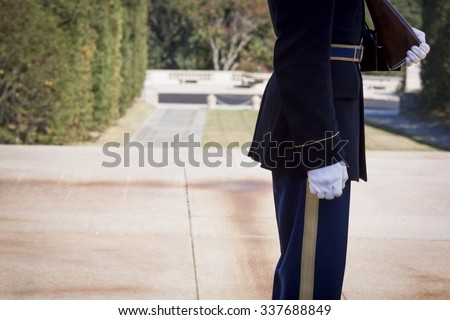 ARLINGTON, VA - SEPT 11, 2015: One of the sentinels from the 3rd U.S. Infantry Regiment maintaining a 24-hour, 365 days a year vigil at the Tomb of the Unknown Soldier in Arlington National Cemetery. - stock photo
