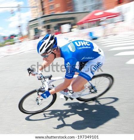 ARLINGTON, VIRGINIA - JUNE 7: A cyclist competes in the elite men's Clarendon Cup race at the Air Force Cycling Classic on June 7, 2014 in Arlington, Virginia - stock photo