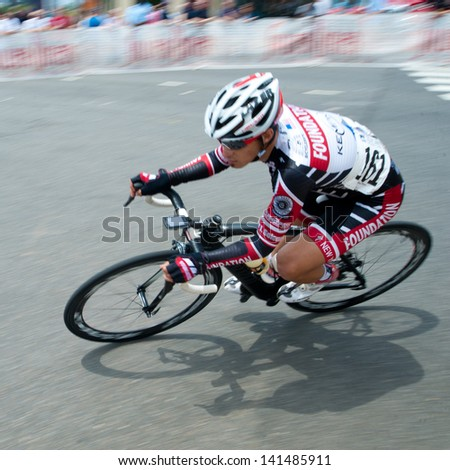ARLINGTON, VIRGINIA - JUNE 8: A cyclist competes in the Men's Pro Invitational at the U.S. Air Force Cycling Classic on June 8, 2013 in Arlington, Virginia - stock photo