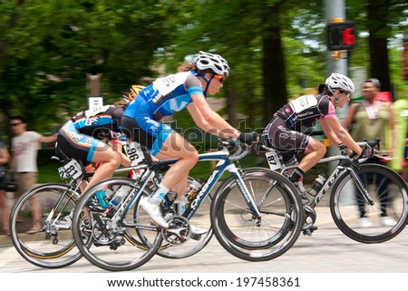 ARLINGTON, VIRGINIA - JUNE 8: Cyclists compete in the Crystal Cup elite women's race at the Air Force Cycling Classic on June 8, 2014 in Arlington, Virginia - stock photo
