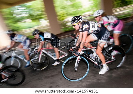 ARLINGTON, VIRGINIA - JUNE 9: Cyclists compete in the elite women's race at the  Air Force Cycling Classic on June 9, 2013 in Arlington, Virginia - stock photo