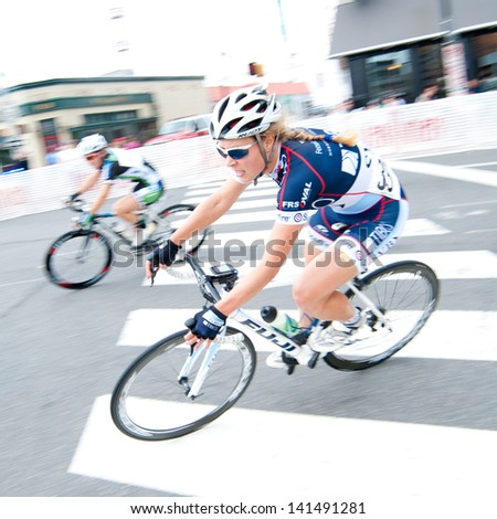 ARLINGTON, VIRGINIA - JUNE 8: Cyclists compete in the elite women's race at the U.S. Air Force Cycling Classic on June 8, 2013 in Arlington, Virginia - stock photo