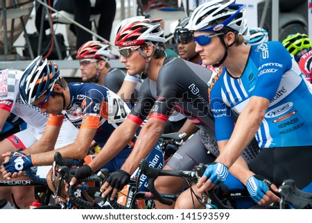 ARLINGTON, VIRGINIA - JUNE 9: Cyclists prepare for the Men's Pro/1 race at the Air Force Cycling Classic on June 9, 2013 in Arlington, Virginia - stock photo