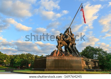 ARLINGTON, VIRGINIA - MARCH 21, 2013:  The Marine Corp War statue illustrates six men who raised the second flag at Iwo Jima battle, and is designed by Felix de Weldon based on Joe Rosenthal's photo. - stock photo