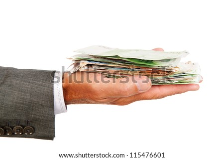 Arm and hand of business man with lots of Euros in banknotes - stock photo