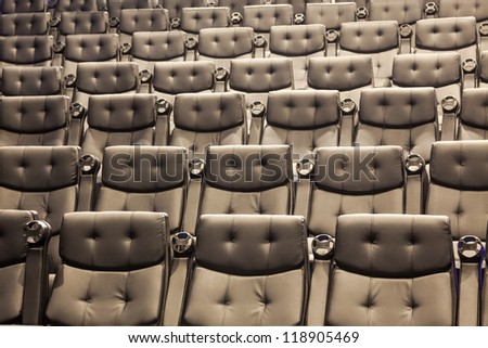 arm chairs in the cinema - stock photo
