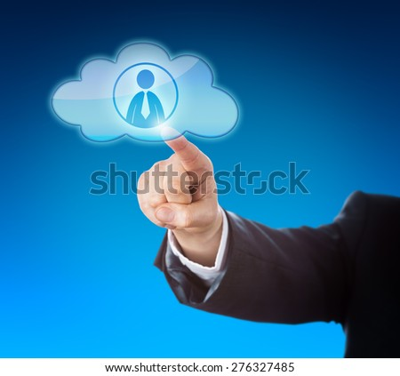 Arm in dark blue business suit reaching out to point at a knowledge worker icon inside a floating cloud computing symbol. Technology metaphor for resource pooling and smart computing solutions. - stock photo