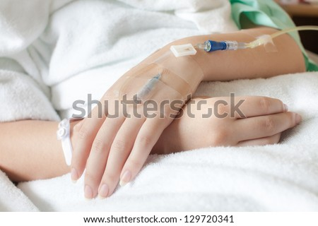 Arm of a female patient in the hospital - stock photo