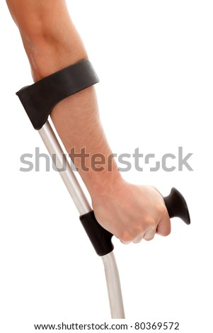 Arm of a man holds a crutch isolated on white background - stock photo