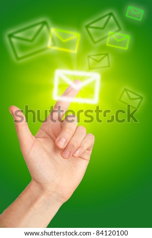 arm press the digital button (icon of letter) - stock photo