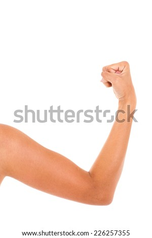 Arm with a clenched fist - stock photo