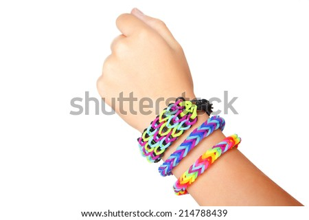 arm with rubber band bracelets - stock photo