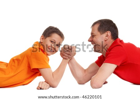 arm wrestling for father and son on white - stock photo