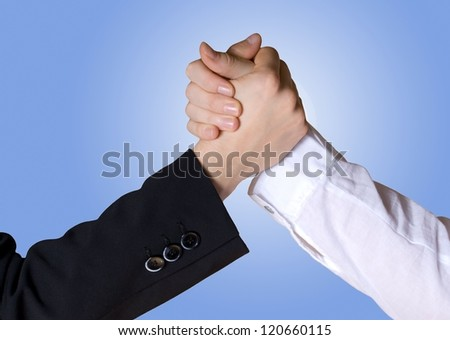 arm wrestling/hands symbolizing team/competition/leading - stock photo