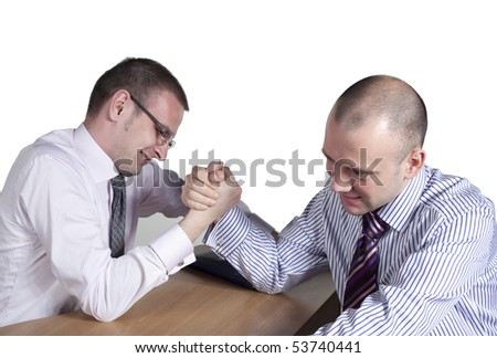 Arm wrestling in the office - stock photo