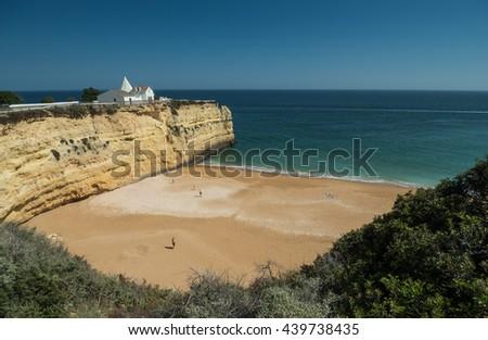 ARMACAO DE PERA, PORTUGAL - MAY 18: A view of  the chapel Capela Nossa Senhora da Rocha on the coast Algarve near city Armacao de Pera in the south of the country, Portugal, 2016 - stock photo