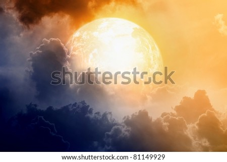 Armageddon, dramatic dark background - glowing planet Earth in sky with clouds - stock photo