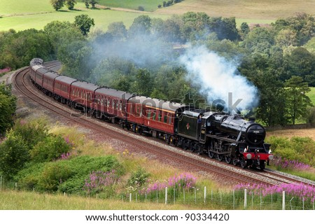 ARMATHWAITE, ENGLAND - JULY 23: Preserved steam locomotive 45305 heads the Cumbrian Mountain Express through Armathwaite on July 23, 2011, on the Settle to Carlisle railway. - stock photo