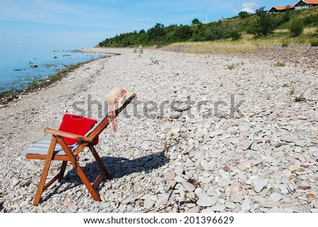 Armchair at the coast on the island oland in Sweden - stock photo
