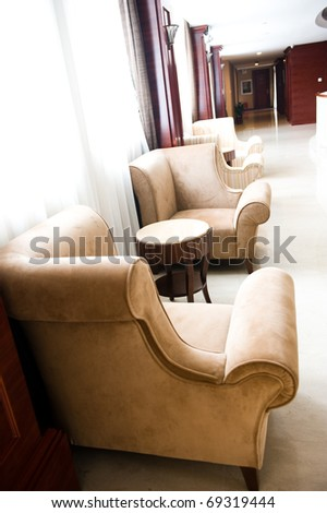 armchair close to a window for rest. - stock photo