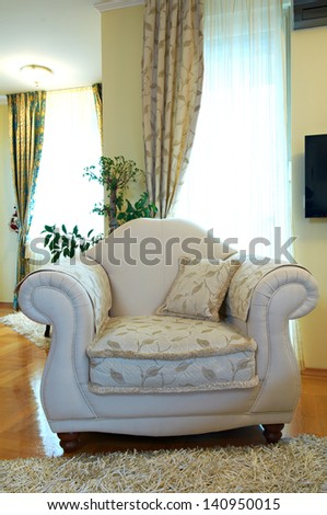 Armchair in classic living room - stock photo