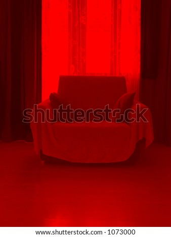 Armchair in red room