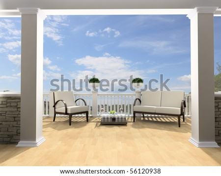 Armchairs and a table on an open terrace - stock photo