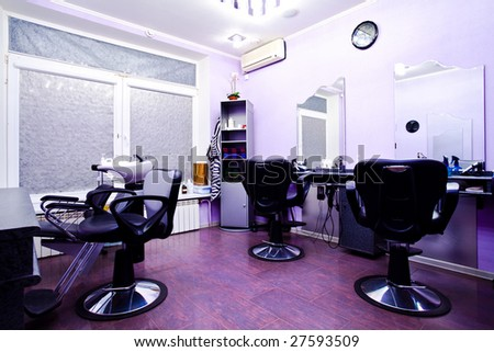 Armchairs in hairdressing salon interior - stock photo