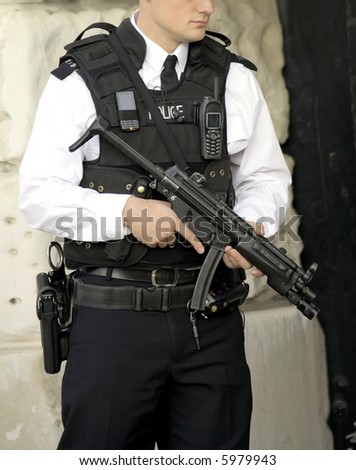 armed british police officer on duty