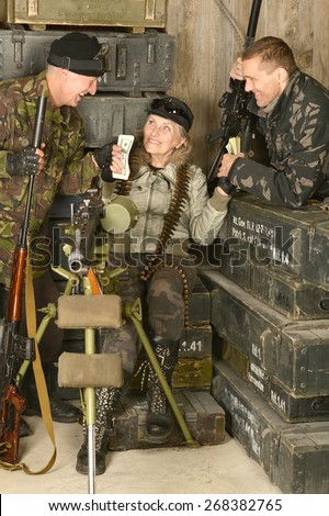 Armed combat soldiers smiling in ammunition close-up - stock photo