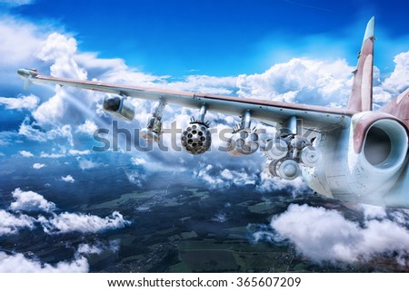 Armed fighter jet in the sky. - stock photo