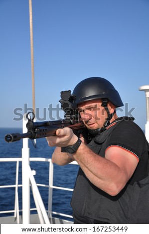 armed guard on board sea going vessel in aden gulf - stock photo