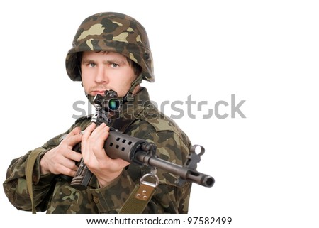 Armed man holding svd in studio. Closeup