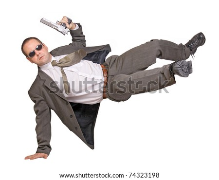 armed man in a suit jumping - stock photo