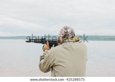 Armed man in a zone of armed conflict. - stock photo
