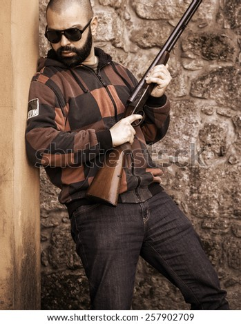 Armed Man Ready to Action - stock photo