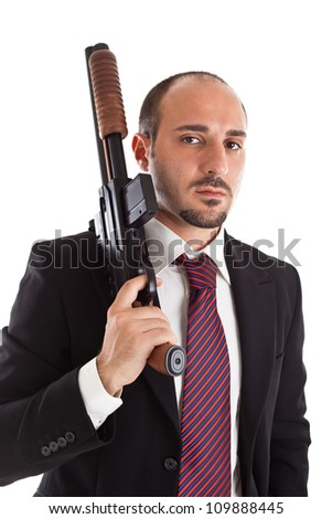 Armed Mobster or businessman with shotgun - stock photo