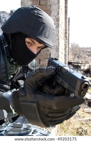 Armed officer targeting with a semi-automatic glock pistol - stock photo