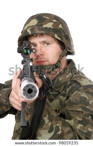 Armed soldier aiming m16 in studio. Isolated - stock photo
