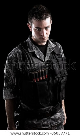 armed soldier isolated on a black background