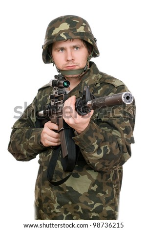 Armed soldier pointing m16 in studio. Upperhalf