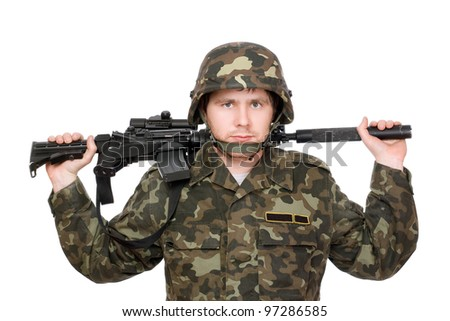 Armed soldier with m16 on the shoulders - stock photo