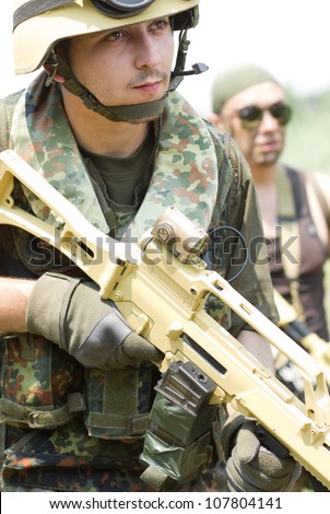 Armed team moving forward to their target - stock photo