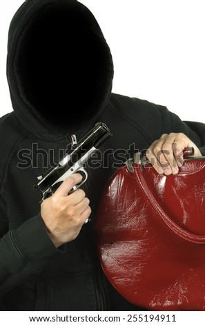 Armed thief steals a purse - stock photo