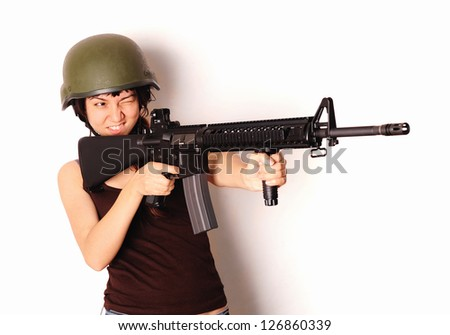 Armed woman posing with weapon. - stock photo