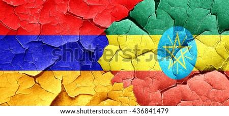 Armenia flag with Ethiopia flag on a grunge cracked wall - stock photo
