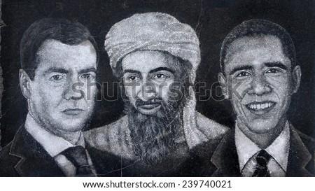 ARMENIA,VANADZOR-12 December  2014:on a granite slab Armenian masters painted portraits of Dmitry Medvedev, Barack Obama and Osama bin Laden. - stock photo