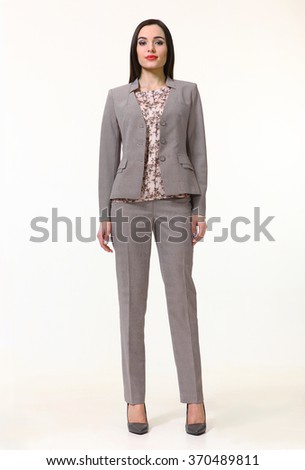armenian asian eastern brunette business executive woman with straight hair style in gray official two pieces jacket trousers suit high heels shoes full length body portrait standing isolated on white - stock photo