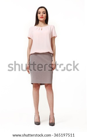 armenian asian eastern brunette business executive woman with straight hair style in pink t-shirt and short skirt  high heels shoes full length body portrait standing isolated on white - stock photo