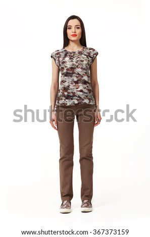 armenian asian eastern brunette business executive woman with straight hair style in printed military khaki blouse and trousers high heels shoes full length body portrait standing isolated on white - stock photo